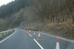 Southern Extension Project - Although nothing to do with the railway but of interest, catch fencing is being installed above the road prior to felling of the trees above through the gorge at Pont Evans.