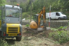 The aim is to sort and profile spoil below the retaining wall and embankment toe, which will become inaccessible as the embankment gets higher.