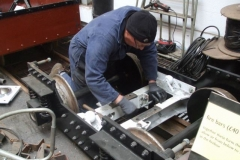 Meanwhile, Andy has been getting on with fitting brake components to one of the carriage bogies …