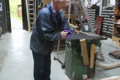 … and Peter cuts timber …