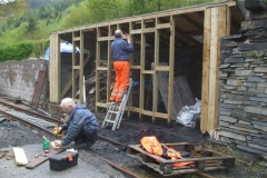 … while Peter and John work on the fuel store enclosure.