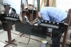 … while nearby, Tony starts undercoating the centre of another carriage bogie ...