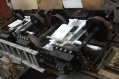 Adjacent, all the brake assemblages on the bogies for carriage No. 23 have been trial fitted although await some minor tweaks. As much as practicable has also been fitted to the bogies of carriage No. 24 but to complete the task, it will first have to be positioned over the pit.
