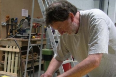 … while Neil prepares amended lettering for the gantry board during his tea break …
