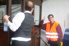 In the Carriage Shed, John gets the thumbs up from Tom for cleaning carriage windows …