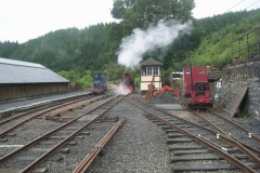 Monday, 10.8.15. On yet another damp morning, the air pump of No. 7 works up to pressure outside the Signal Box with Alan patiently looking on …