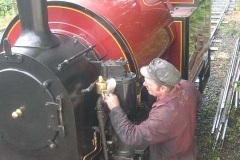 The loco crew undertake some last minute cleaning while awaiting the carriages …