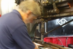 … while in the Engine Shed, Stevie pilots holes in the carriage brake blocks using a jig …