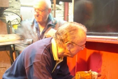 … and Chris drills holes in the buffer beam of loco No. 11 for Bob to tap to secure air brake pipe fittings.