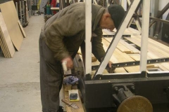 … while Steve starts to clamp the sealed floor planks on carriage No. 23 …