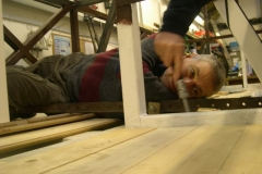 To bolt the floor planks of carriage No. 23 down, requires a contortionist …
