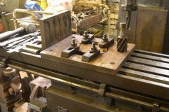 … so he starts setting up to machine the bogie pivot support to fit.