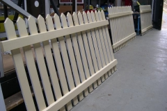 … while painting gloss coat on the fencing panels.