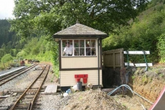 As No. 7 heads past the Signal Box prior to the first train, Graeme is spotted therein, cleaning up.