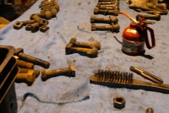 Fishplates and bolts are laid out on a bench in preparation for the The Fishplate Weekender.