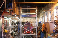 Removing the locomotives from the shed gave room to complete the installation of hangers for the smoke hood …