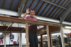 … who turns out to be Neil – fixing the boards to the roof.