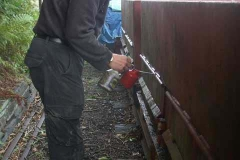 Before putting the ballast waggons away, Stevie gives the door hinges another treatment of lubricant.