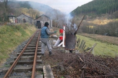 … while another Richard disposes of hedge cuttings in the incinerator.