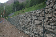 The line of completed gabions stretch into the distance …