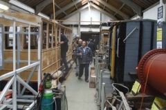 In the Carriage Shed, a motley crew are working on carriages 21 and 23 …
