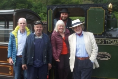 """They are soon joined by special guests (left to right) Stephen Hulme, Jackie Jeffrey and David Hulme (with Trefor and Sam), who are grandchildren of Corris loco engineer Albert Hulme who was largely responsible for choosing the """"Tattoo"""" design from Kerr, Stuart, and arranging adaptations to the original design to suit Corris' needs in 1920/21, while Jackie is granddaughter of Thomas Squire, an engineer who worked with Albert Hulme in the 1920's. The grandchildren had never known of each other's existence before, nor had ever met - until today."""