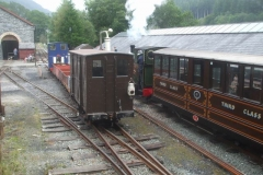 ... while No. 6 poses at the head of a representative freight train on the middle road for visitors to enjoy.