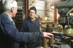 … while Bob distracts Chris, milling parts for track jacks.