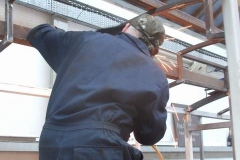 … as he welds in steel on the clerestory roof.