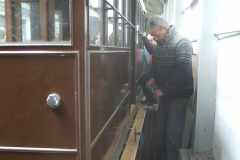A good gang of volunteers has assembled to prepare the footboards for carriage No. 23 …