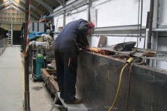 … while Ade grinds back welds ready to fit more steel sheet.