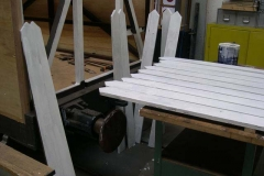 Meanwhile, more timber palings receive their primer …