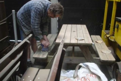… and Tony is finishing off preparation of the picnic table.