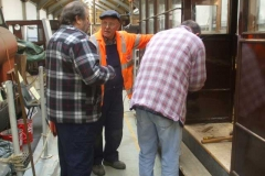 Pete takes a break while Bill and Charles fuss around other details in the vestibule …