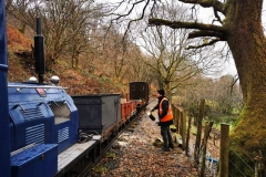 Luke loading the 'Queen Mary' with fresh logs from the cut branches above.