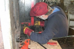 …while Richard removes the valve gear control levers to ease access to some boiler retaining bolts.