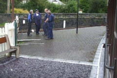 A knot of members assemble on the platform at Corris.