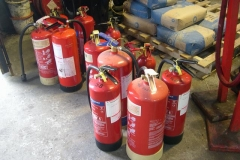 Tuesday, 15.12.15. A line-up of fire extinguishers, all ready for their annual inspection.