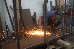 In the Carriage Shed, Adrian is welding up and dressing off holes in the one side of the Drop Side waggon body …