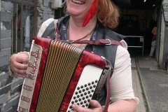 Helen re-starts the entertainment by getting out her squeeze box …
