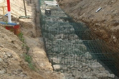 By the end of the day, a start has been made on filling the last gabions at the north end of the wall.