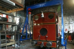 In the Engine Shed, No. 7 is under the newly completed gantry, complete with lifting block and tackle – and is all ready for dismantling of the loco to commence.