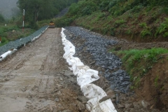 … to blind the coarse stone foundation  drainage layer – in the rain.