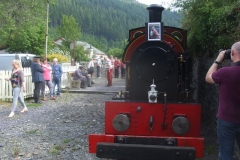 Job done, family members photograph the headboard and train at Corris …