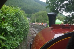 The carnival atmosphere as the train approaches Corris - long after the runners have reached the finishing line!