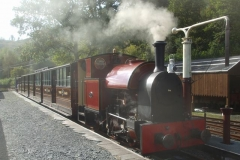 The low sun shows up the train's paintwork well as Stevie prepares the fire for the next run up to Corris ...