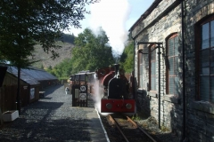 … and heads northwards past the old watering arrangements on the side of the Engine Shed.