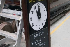"""Nearby, the """"Next Train"""" board for Corris has received a touch-up, ready for the new season …"""