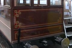 The end panels of carriage No. 22 have received their first coat of gloss paint …