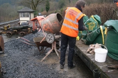 Sunday, 17.1.16. Tony is mixing concrete for the wrong railway, to back behind the new wall in the yard …